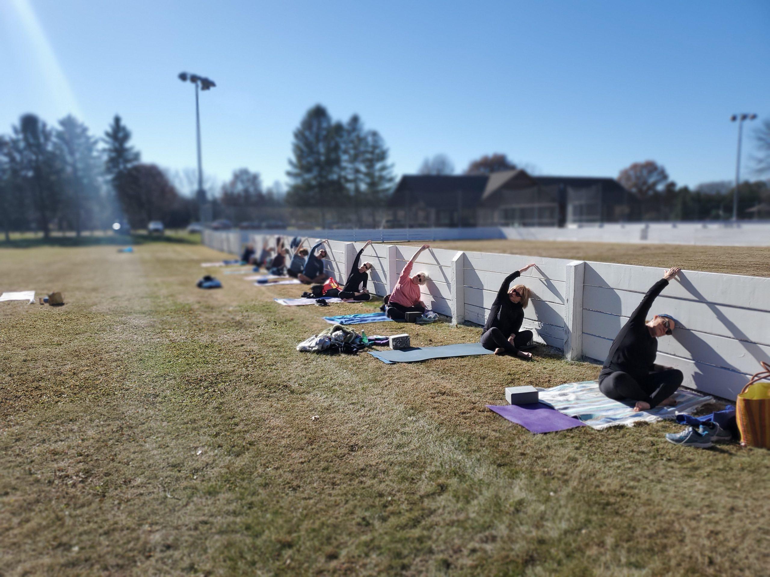 yoga hot dish yoga outside fence stretch